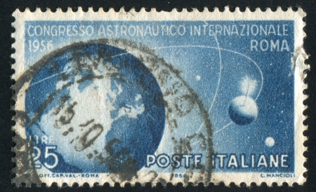 apogee: ITALY - CIRCA 1956: stamp printed by Italy, shows Globe and Satellites, circa 1956