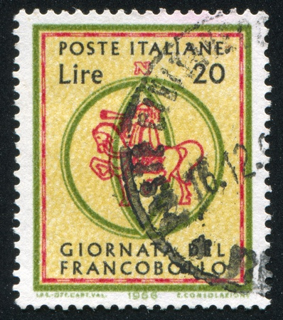 ITALY - CIRCA 1966: stamp printed by Italy, shows Postrider, circa 1966 Stock Photo - 17437487