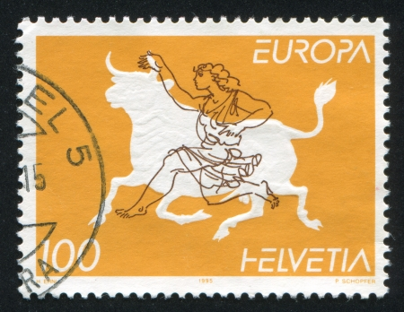 SWITZERLAND - CIRCA 1995: stamp printed by Switzerland, shows Zeus disguised as bull abducting Europa, circa 1995 Stock Photo - 17464505