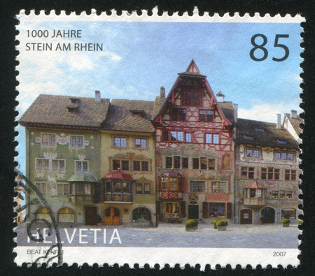SWITZERLAND - CIRCA 2007: stamp printed by Switzerland, shows Houses on Town Hall Square, circa 2007 Stock Photo - 17464624