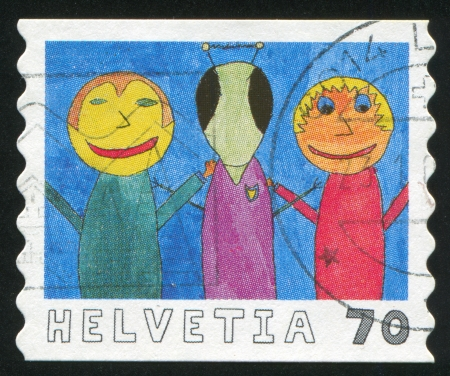 SWITZERLAND - CIRCA 2000: stamp printed by Switzerland, shows Alien from outer space by Yannik Kehrli, circa 2000 Stock Photo - 17464424