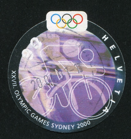 SWITZERLAND - CIRCA 2000: stamp printed by Switzerland, shows Cyclist, circa 2000 Stock Photo - 17464551