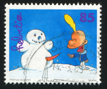 SWITZERLAND - CIRCA 2004: stamp printed by Switzerland, shows Titeuf pointing at snowman by Zep, circa 2004