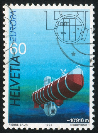SWITZERLAND - CIRCA 1994: stamp printed by Switzerland, shows Bathyscaphe Trieste of August and Jacques Piccard, circa 1994 Stock Photo - 17437400