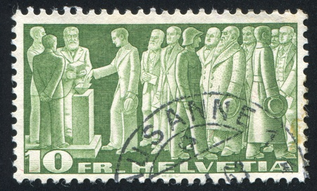 SWITZERLAND - CIRCA 1938: stamp printed by Switzerland, shows Citizens Voting, circa 1938 Stock Photo - 17464499