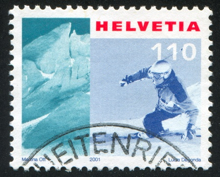 SWITZERLAND - CIRCA 2001: stamp printed by Switzerland, shows Kleine Matterhorn Glacier, skier, circa 2001 Stock Photo - 17464481
