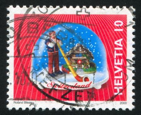 SWITZERLAND - CIRCA 2000: stamp printed by Switzerland, shows Aphorn, Swiss Souvenirs, circa 2000 Stock Photo - 17464533