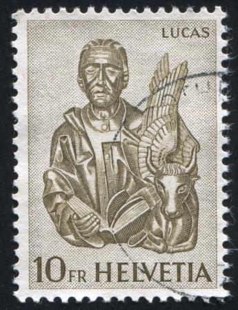 ルーク: SWITZERLAND - CIRCA 1961: stamp printed by Switzerland, shows St. Luke and winged ox, circa 1961