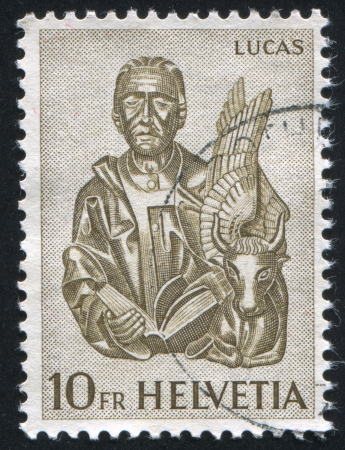 SWITZERLAND - CIRCA 1961: stamp printed by Switzerland, shows St. Luke and winged ox, circa 1961 Stock Photo - 17464642