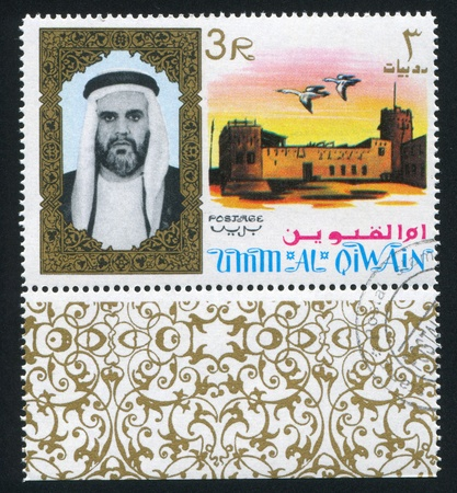 UMM AL-QUWAIN - CIRCA 1972: stamp printed by Umm al-Quwain, shows Sheikh and Geese, circa 1972 Stock Photo - 17464611