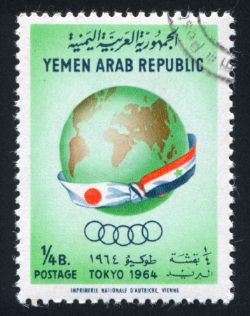 YEMEN - CIRCA 1964: stamp printed by Yemen, shows Globe and Flag of Jemen and Japan, circa 1964 Stock Photo - 17437386