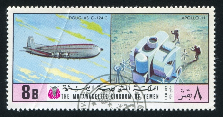 YEMEN - CIRCA 1976: stamp printed by Yemen, shows Douglas C 124 C and Apollo 11, circa 1976 Stock Photo - 17437461