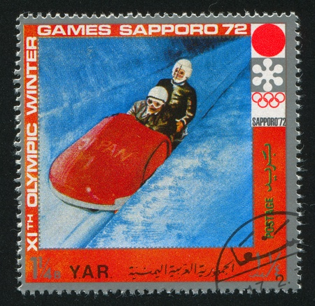 YEMEN - CIRCA 1972: stamp printed by Yemen, shows Bobsleigh, circa 1972 Stock Photo - 17464454