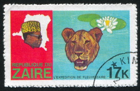ZAIRE - CIRCA 1978: stamp printed by Zaire, shows Head of Leopard and Victoria Regia lily, circa 1978 Stock Photo - 17464559