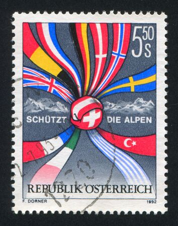 AUSTRIA - CIRCA 1992: stamp printed by Austria, shows Protection of the Alps, flags, circa 1992