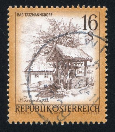 window seal: AUSTRIA - CIRCA 1977: stamp printed by Austria, shows draw well, house, tree, circa 1977