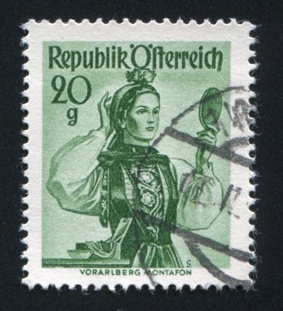 AUSTRIA - CIRCA 1948: stamp printed by Austria, shows Austrian costume in Vorarlberg, Montafon, circa 1948 Stock Photo - 17837742