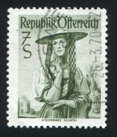 AUSTRIA - CIRCA 1948: stamp printed by Austria, shows Austrian costume in Steiermark, Sulm Valley, circa 1948 Stock Photo - 17809669