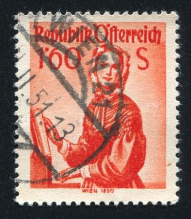 AUSTRIA - CIRCA 1948: stamp printed by Austria, shows Austrian costume in Vienna, circa 1948 Stock Photo - 17837738