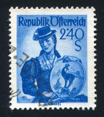 AUSTRIA - CIRCA 1948: stamp printed by Austria, shows Austrian costume in Kitzbuhel, circa 1948 Stock Photo - 17837784