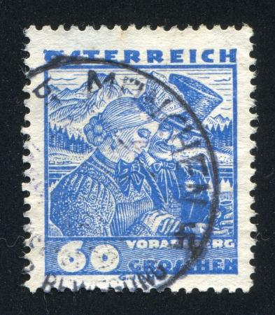 AUSTRIA - CIRCA 1932: stamp printed by Austria, shows Vorarlberg bridal couple, circa 1932 Stock Photo - 17837802