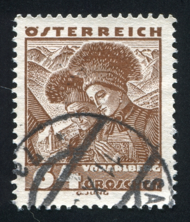 AUSTRIA - CIRCA 1932: stamp printed by Austria, shows Costumes in Vorarlberg, circa 1932 Stock Photo - 17809638