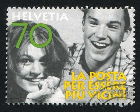 SWITZERLAND - CIRCA 1997: stamp printed by Switzerland, shows Laughing people, circa 1997 Stock Photo - 17837787
