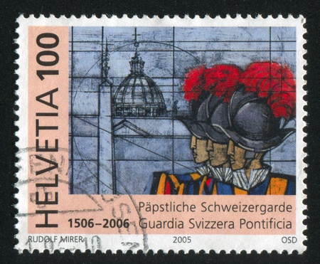 casque: SWITZERLAND - CIRCA 2005: stamp printed by Switzerland, shows Swiss Papal guards and Basilica of Saint Peter, circa 2005