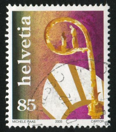 SWITZERLAND - CIRCA 2005: stamp printed by Switzerland, shows Crozier and miter, circa 2005 Stock Photo - 17809646