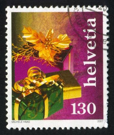 god box: SWITZERLAND - CIRCA 2007: stamp printed by Switzerland, shows Gifts, circa 2007