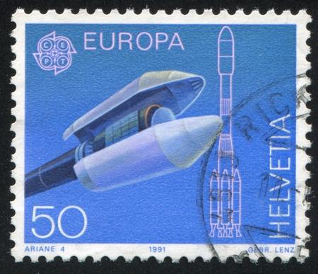 payload: SWITZERLAND - CIRCA 1991: stamp printed by Switzerland, shows Ariane payload fairing, circa 1991