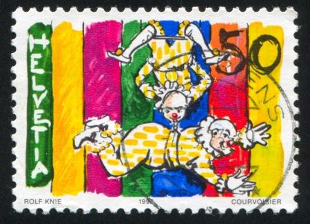 trapeze: SWITZERLAND - CIRCA 1992: stamp printed by Switzerland, shows Clowns on trapeze, circa 1992