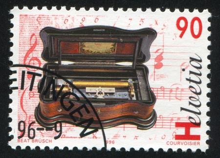 eduard: SWITZERLAND - CIRCA 1996: stamp printed by Switzerland, shows Basso piccolo mandolin cylinder music box by Eduard Jaccard, circa 1996 Editorial