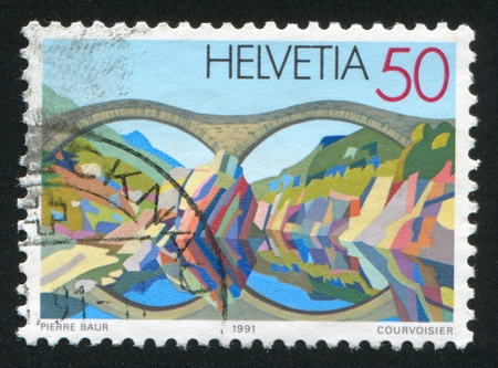 SWITZERLAND - CIRCA 1991: stamp printed by Switzerland, shows Stone bridge near Lavertezzo, circa 1991 Stock Photo - 17838260