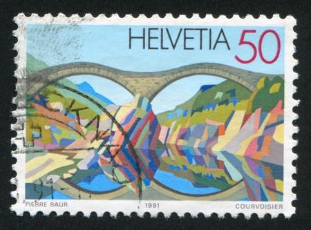 SWITZERLAND - CIRCA 1991: stamp printed by Switzerland, shows Stone bridge near Lavertezzo, circa 1991 Stock Photo - 17838260