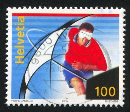 impaired: SWITZERLAND - CIRCA 2005: stamp printed by Switzerland, shows Visually impaired soccer player, circa 2005