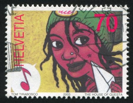 SWITZERLAND - CIRCA 2003: stamp printed by Switzerland, shows Women and musical note, circa 2003 Stock Photo - 17838233