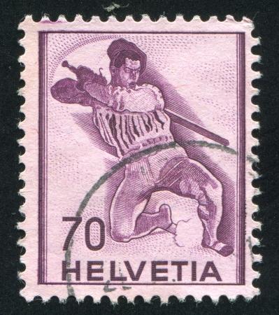 adroitness: SWITZERLAND - CIRCA 1941: stamp printed by Switzerland, shows Fighting Soldier, circa 1941
