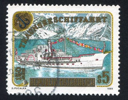 AUSTRIA - CIRCA 1989: stamp printed by Austria, shows Paddle Steamer Gisela, mountains, circa 1989