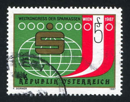 AUSTRIA - CIRCA 1987: stamp printed by Austria, shows stylized globe, emblem, circa 1987
