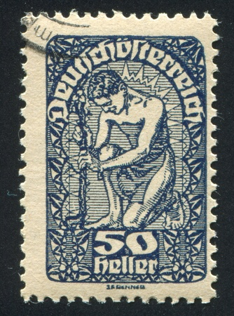 AUSTRIA - CIRCA 1919: stamp printed by Austria, shows Man and flower, circa 1919 Stock Photo - 18113083