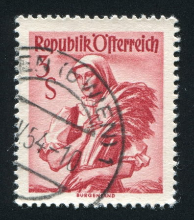 AUSTRIA - CIRCA 1949: stamp printed by Austria, shows Woman in Austian costumes, circa 1949 Stock Photo - 18113101
