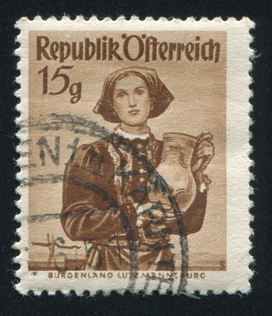 headcloth: AUSTRIA - CIRCA 1948: stamp printed by Austria, shows Woman in Austian costumes, circa 1948