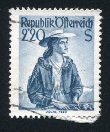 AUSTRIA - CIRCA 1952: stamp printed by Austria, shows Woman in Austian costumes, circa 1952 Stock Photo - 18113174