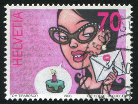 SWITZERLAND - CIRCA 2003: stamp printed by Switzerland, shows Woman and birthday cake, circa 2003 Stock Photo - 18113112