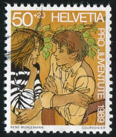 SWITZERLAND - CIRCA 1989: stamp printed by Switzerland, shows Friendship, circa 1989 Stock Photo - 18114438