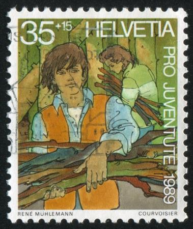 SWITZERLAND - CIRCA 1989: stamp printed by Switzerland, shows Community work, circa 1989 Stock Photo - 18114152