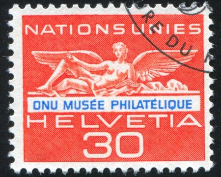 SWITZERLAND - CIRCA 1962: stamp printed by Switzerland, shows Statue from UN building in Geneva, circa 1962 Stock Photo - 18114166