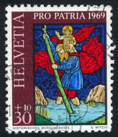 SWITZERLAND - CIRCA 1969: stamp printed by Switzerland, shows Saint Christopher from Laufelfinger church, circa 1969