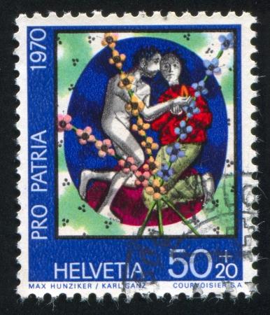 SWITZERLAND - CIRCA 1970: stamp printed by Switzerland, shows Man and woman by Max Hunziker and Karl Ganz, circa 1970 Stock Photo - 18114180